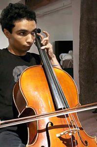 A young adult man with autism playing the viola
