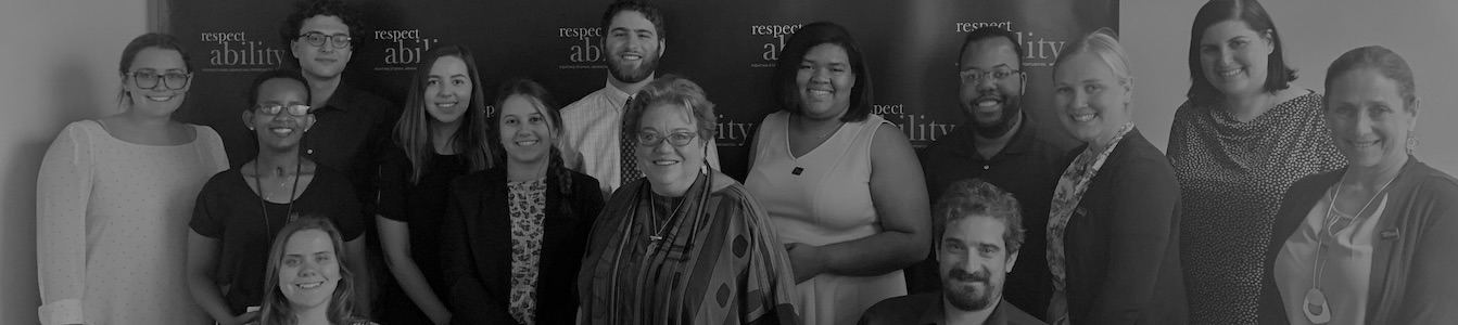 RespectAbility Summer 2019 Fellows, Staff, and guest speaker Celinda Lake smiling in front of the RespectAbility banner
