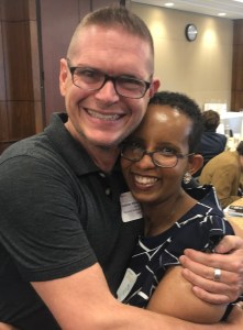 Laka Mitiku Negassa hugs a man who helped her recover from her brain injury at RespectAbility's 2019 summit