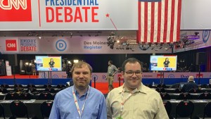 James Trout and Eric Ascher smile inside the spin room at the CNN Democratic Debate
