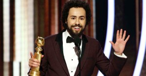 Ramy Youssef on stage at the 77th Annual Golden Globes Award speaking with his award for Best Actor in his hand