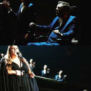 Tobias Forrest and Victoria Canal performing in a choir with Chrissy Metz on stage at the Academy awards