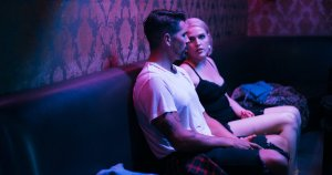 Scene from Single with Kim and Jake on a blind date together inside a bar