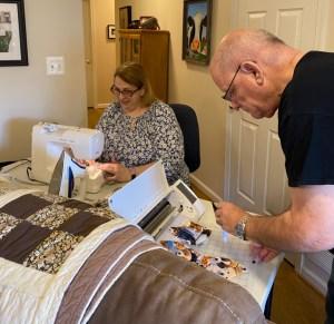 Tonya Koslo and her husband Tim making masks in her house