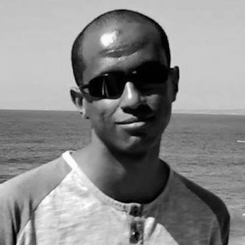 Nebiyu Dingetu headshot in front of the ocean
