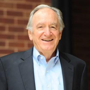 Senator Tom Harkin smiling headshot wearing a suit