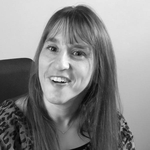Blair Webb smiling headshot seated in a chair