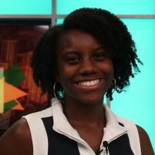 Kianna Dorsey smiling headshot on a television set