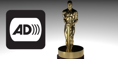 An award statue next to the icon for audio description