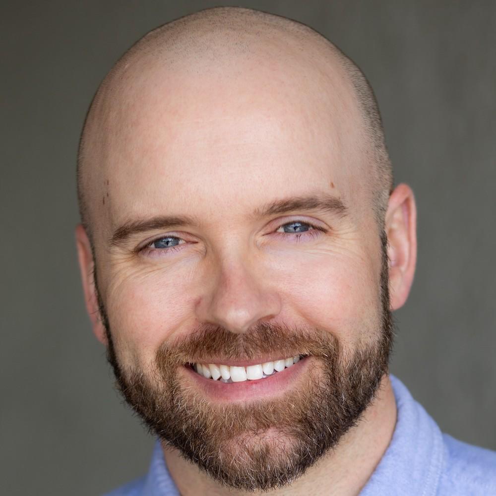 Justin Sloan headshot smiling