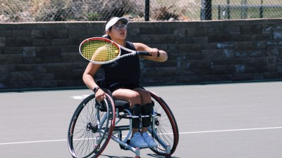 Krista Ramirez-Villatoro playing tennis. She is a wheelchair user.