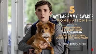 A scene from Healing Powers of Dude with Jace Chapman as Noah holding a dog inside a school. Text: 5 Daytime Emmy Awards Nominations, including Principal Performance in a Children's Program - Jace Chapman, Directing team for a preschool, children's or family viewing program. The Healing Powers of Dude. Netflix icon.