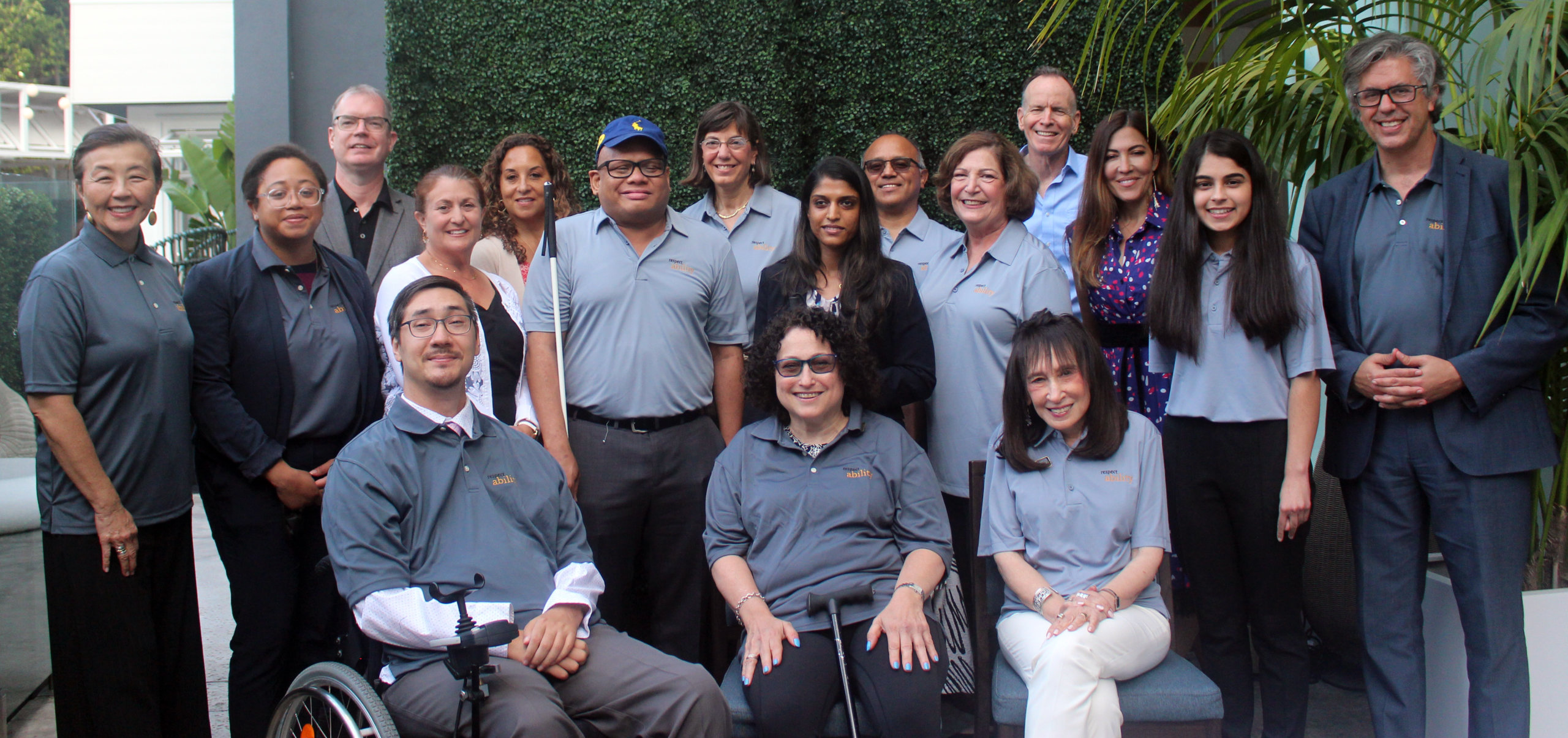RespectAbility Board members smiling together, many wearing polo shirts with the RespectAbility logo on it