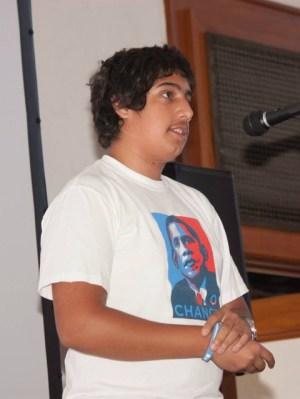 David Sharif giving a speech wearing an Obama Change poster t-shirt