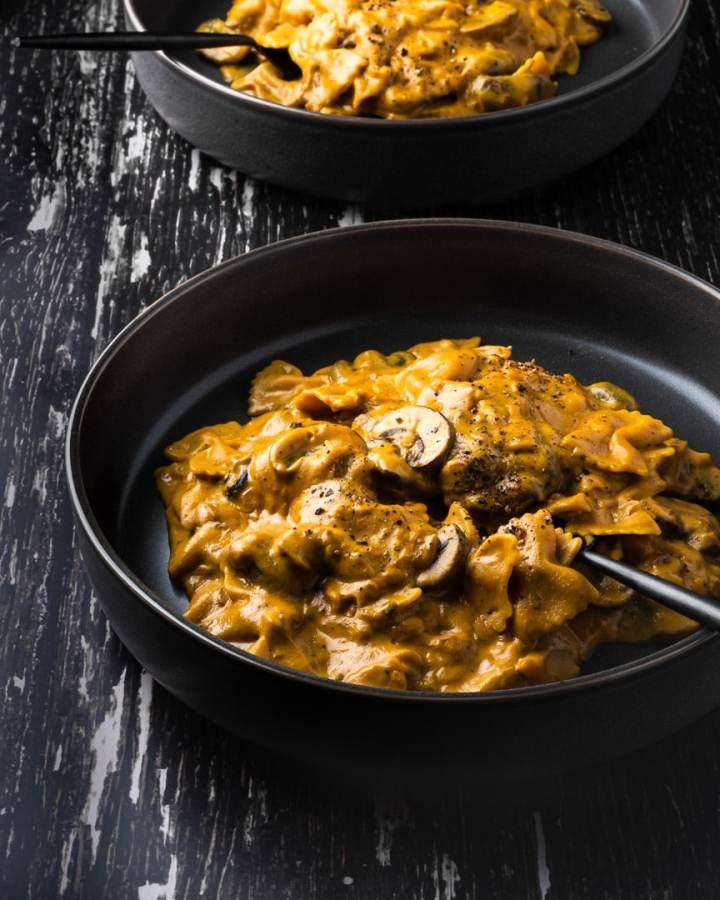two bowls of creamy mushroom sweet potato chickpea pasta
