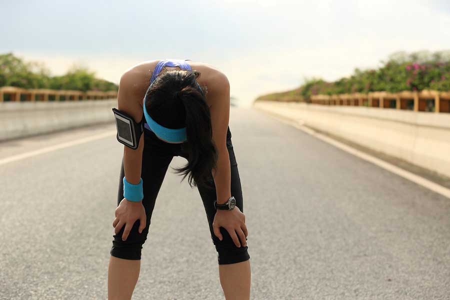 bigstock-tired-woman-runner-taking-a-re-93403139