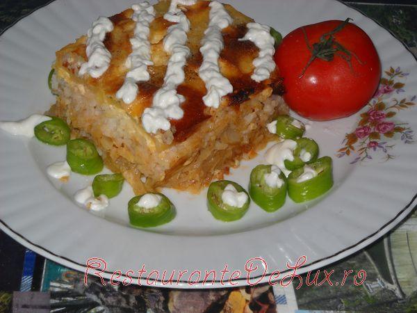 Reteta zilei: Varza calita cu orez si cartofi