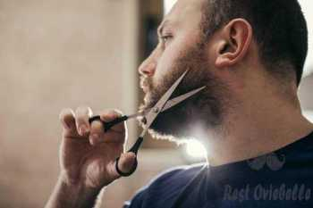 Man cutting beard  Do one side first and then the other trim a beard with scissor