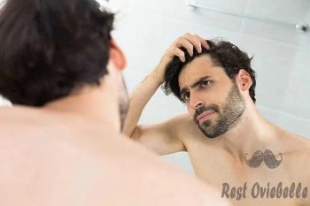 Man having hair loss problem Why Your Hair Stops Growing?