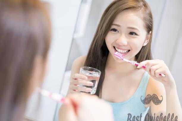 woman take tooth brush whitening mouthwashes
