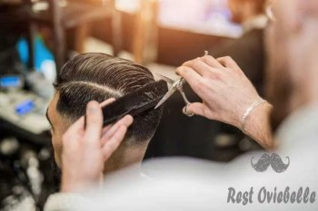 rear view of young man getting a modern haircut. - barbers s and pictures The Best Edgers For Barbers Tips