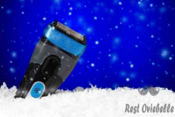 waterproof electric shaver frozen in ice on blue background - waterproofing electric shaver s and pictures Things To Consider When Buying An Electric Shaver