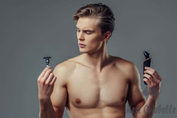 handsome man on grey background. - body shaver men s and pictures Why Using a Body Groomer