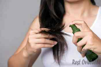 healthy concept. woman hand holding damaged long hair with oil hair treatment. - using natural oil in your hair s and pictures Things To Consider When Using Natural Oil In Your Hair