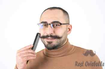 Using a comb to trim your mustache