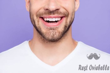 close-up cropped portrait of attractive trendy stylish toothy man with wide beaming smile and healthy teeth over pastel violet purple background - beard implants stock pictures royalty-free photos & images