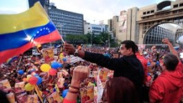 Venezuelan President Nicolas Maduro waves his country's flag at the campaign close for primary elections for the ruling Socialist party, June 26, 2015. | Photo: AVN Previous