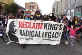 January 18, 2016, Demonstrators reclaim the legacy of Martin Luther King in the streets of Oakland CA. photo: Bill Hackwell