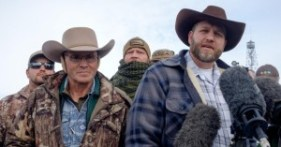 Ammon Bundy(R), leader of a group of armed anti-government protesters speaks to the media as other members look on at the Malheur National Wildlife Refuge near Burns, Ore., on Jan. 4, 2016. (Photo: Rob Kerr/AFP/Getty Images)