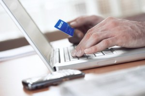 Man shopping online with credit card --- Image by © Kate Kunz/Corbis
