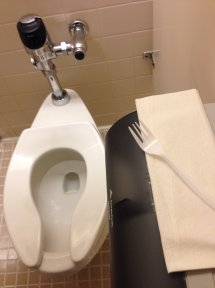 Which coworker is eating their lunch on the toilet?