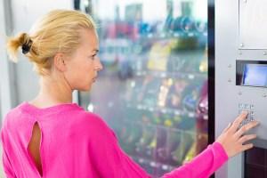 bigstock-Lady-using-a-modern-vending-m-70775662 (1)