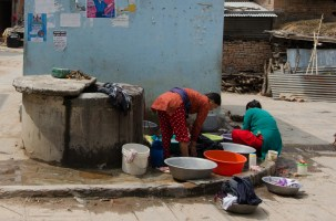 Washing clothes at the well