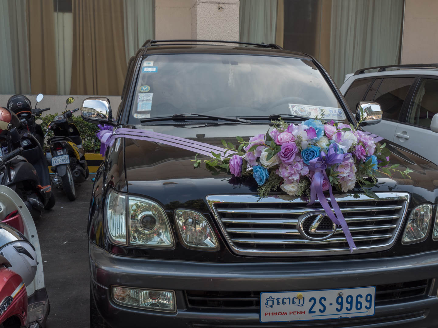 truck decorated with flowers for a wedding