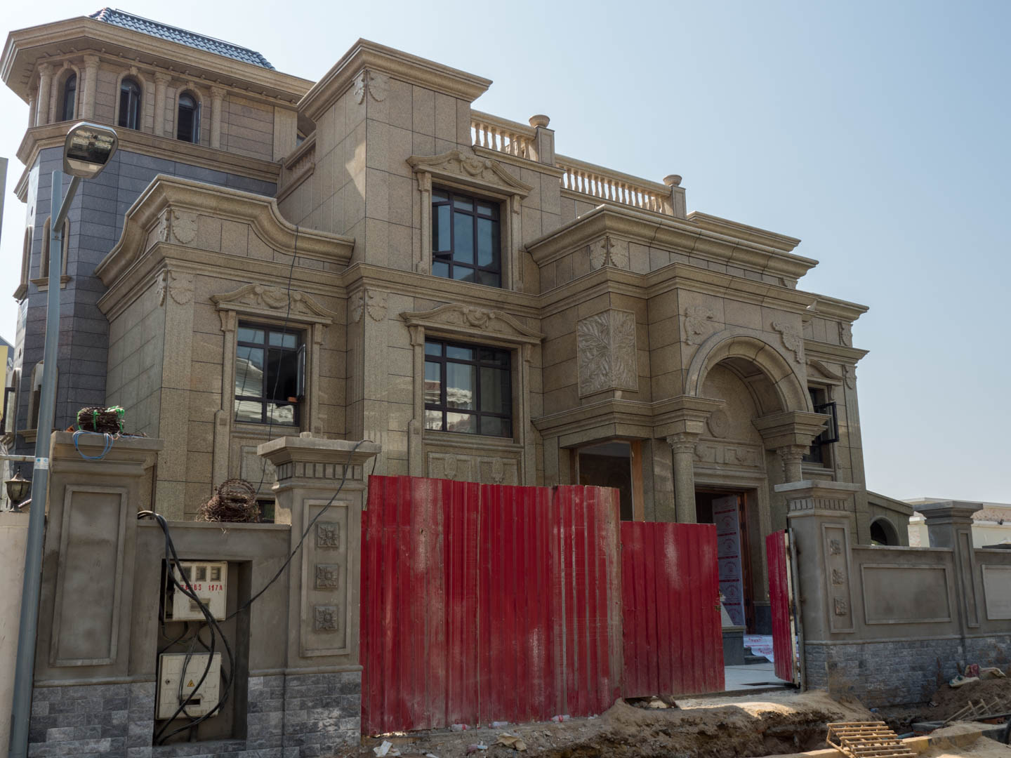 large stone house being built in Koh Pich, Phnom Penh