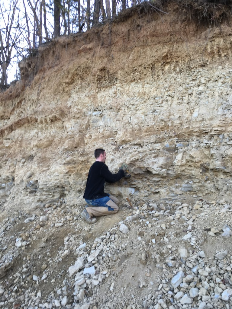 Chiseling geodes out of the shale.