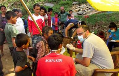 ROKPA's medical team and older children on an aid trip. Image courtesy of ROKPA's Facebook page.