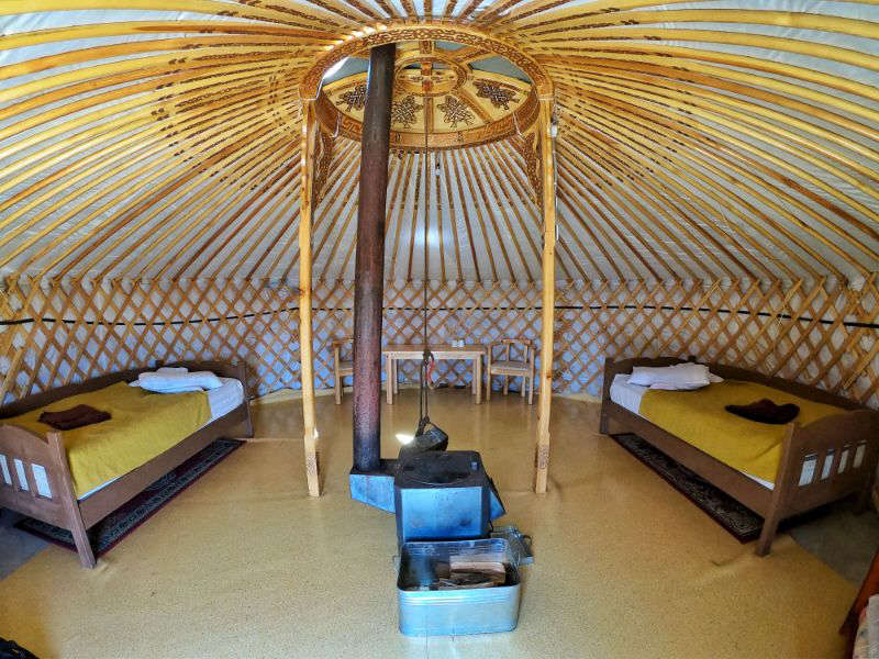 Twins beds in the interior of a ger (yurt) in a tourist camp in Mongolia.
