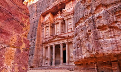 Visit the red rocks of the Treasury carved at Petra in Jordan