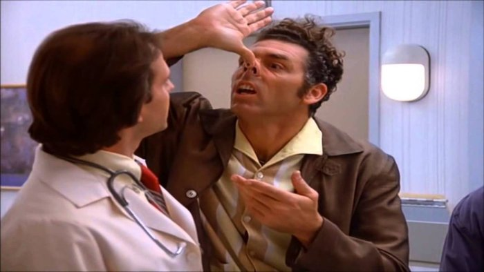 Seinfeld's funny man, Kramer making a joke by pushing his nose up