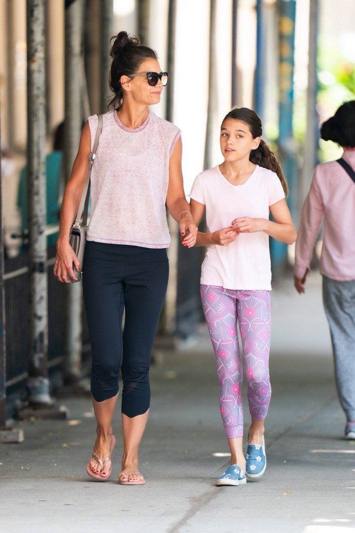 katie holmes and daughter suri cruise on a walk