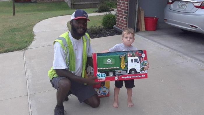 Sanitation worker gives toy recycle truck to kid who regularly greets him