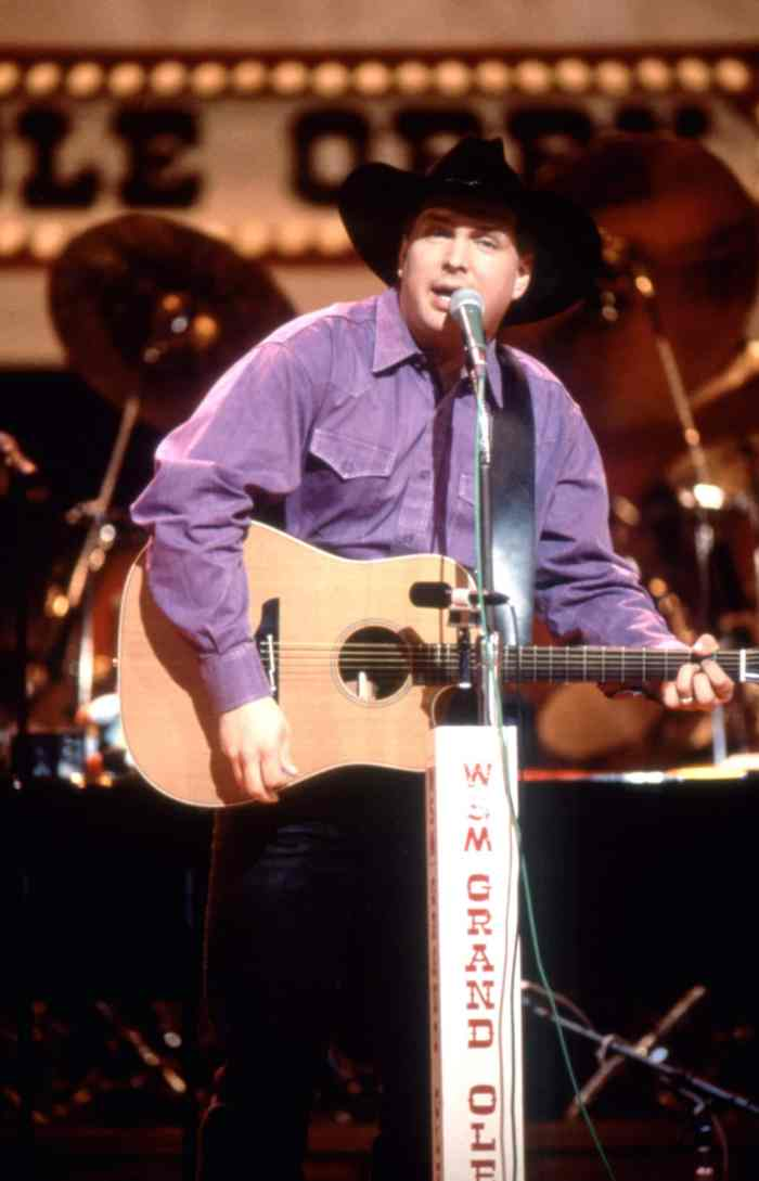 Garth Brooks performing at the Grand Ole Opry