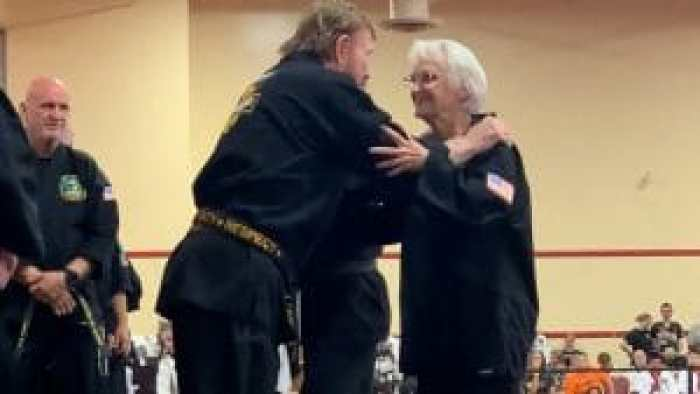 Chuck Norris presents 83-year-old grandma Carole Taylor with a black belt - and hug