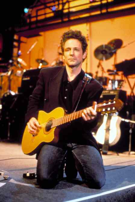 LINDSEY BUCKINGHAM, performing on the TV special (Center Stage), June 21, 1993