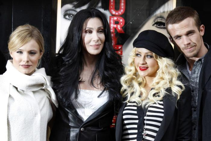 Cher in 2010 with her 'Burlesque' cast